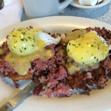 corned beef hash benedict over potato latkes